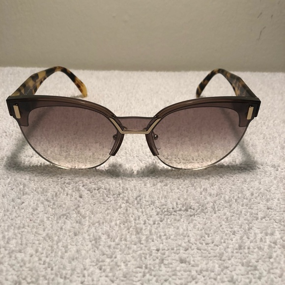 4717de0450 PRADA Transparent Brown Sunglasses. M 5b7ba2a915379578fac431cf